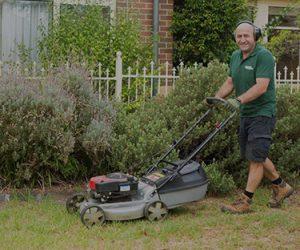 A Fanastic gardener mowing a lawn